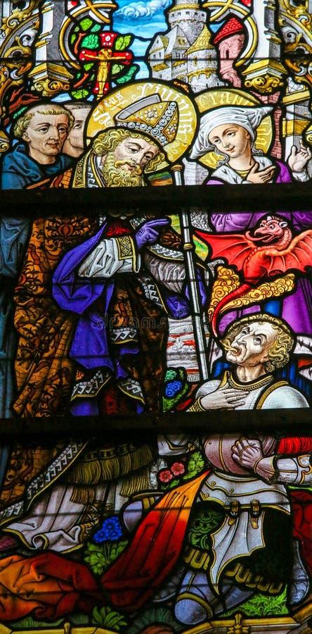Цветное стекло - Святой Livinus стоковая фотография