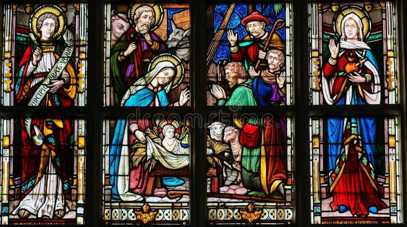 Цветное стекло - сцена рождества на рождестве иллюстрация штока