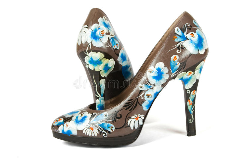 цветок кренит высокие напечатанные ботинки стоковые фото