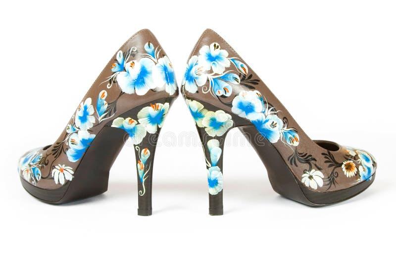 цветок кренит высокие напечатанные ботинки стоковое фото