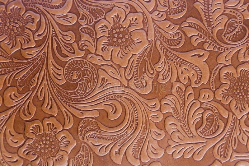 Цветочный узор выбитый кожей стоковая фотография