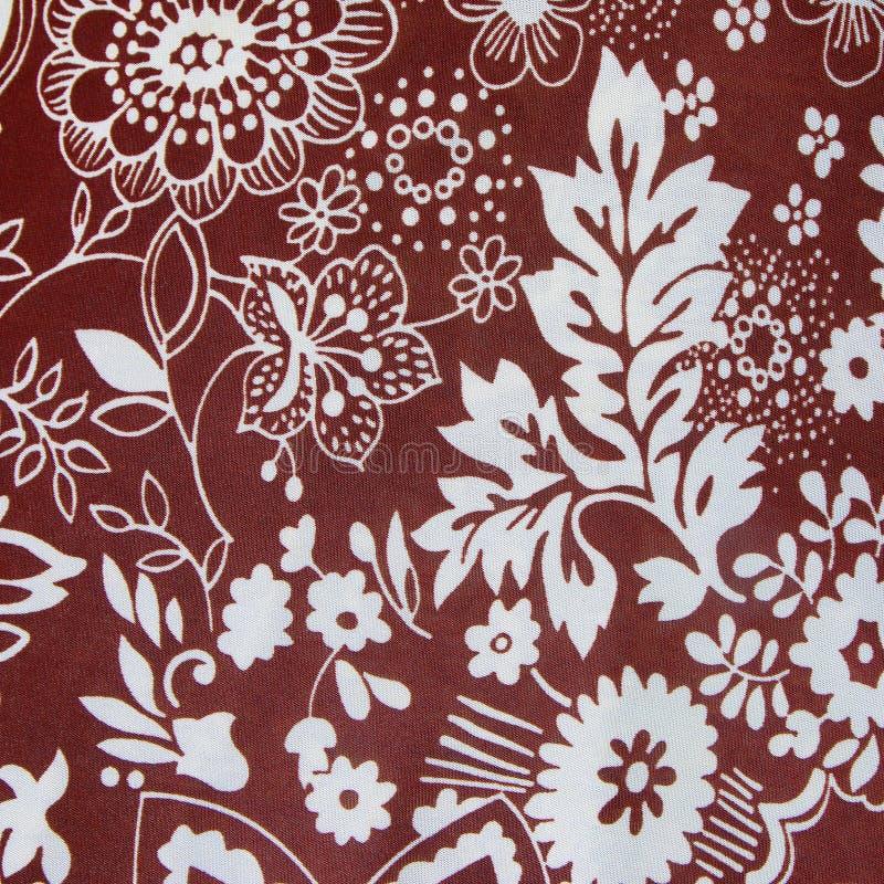 Цветочный узор ткани текстуры предпосылки красный стоковое изображение