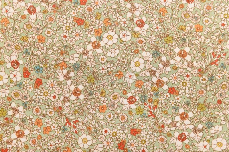 Цветочный узор ткани текстуры предпосылки стоковая фотография