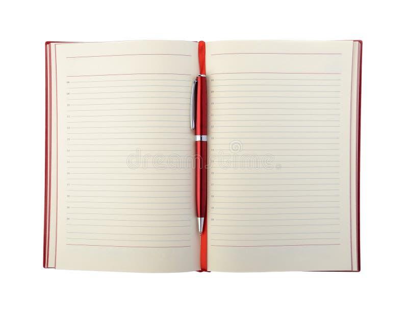 Цвет дневника и ручки красный стоковые фотографии rf