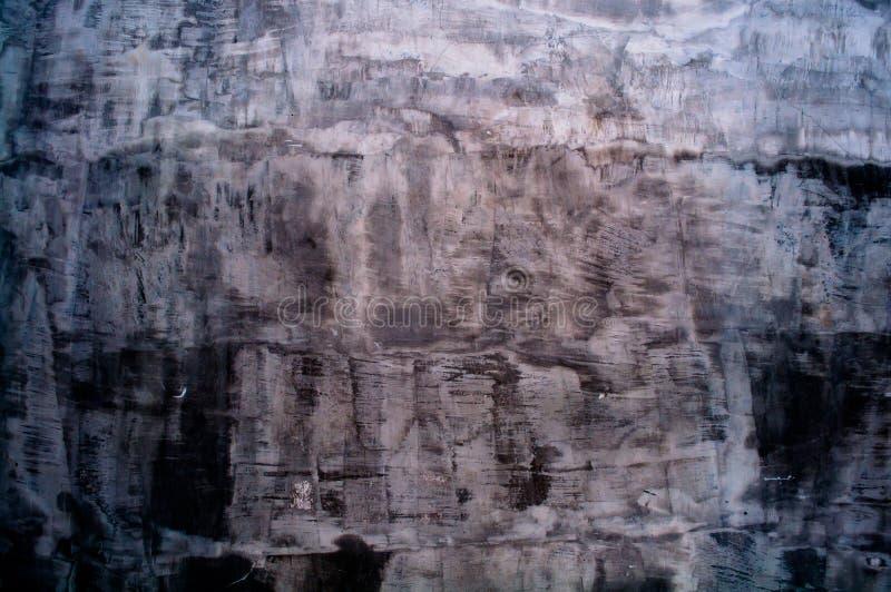 Цвет покрашенной стены черный и коричневый стоковое изображение