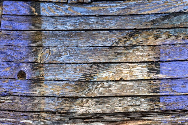 Цвет старой краски голубой и желтый на грязной деревянной поверхности стоковая фотография rf