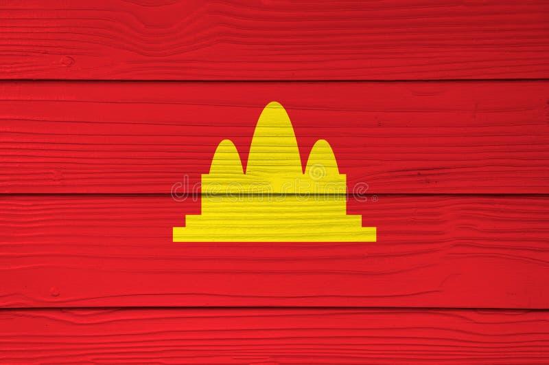 Цвет флага Democratic Kampuchea покрашенный на предпосылке стены листа цемента волокна стоковое изображение rf