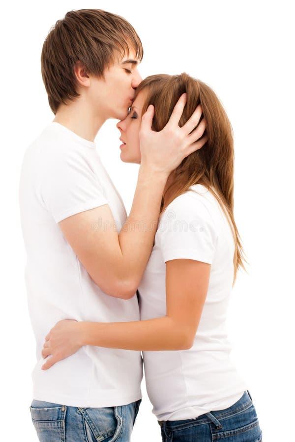 целовать женщину человека стоковое фото rf