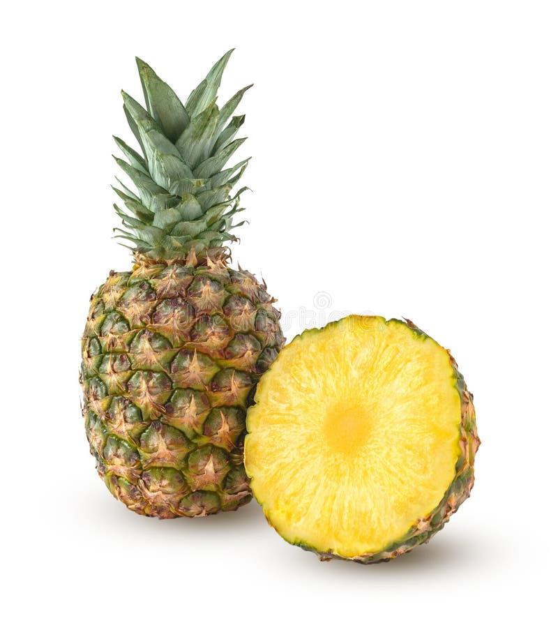 Целый и половина ананаса на белизне стоковые фотографии rf