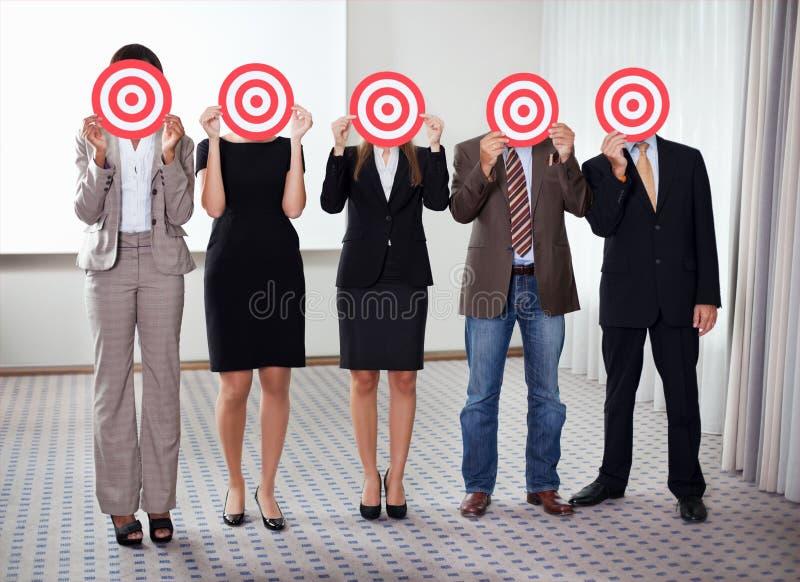 цель людей удерживания бизнес-группы стоковое фото