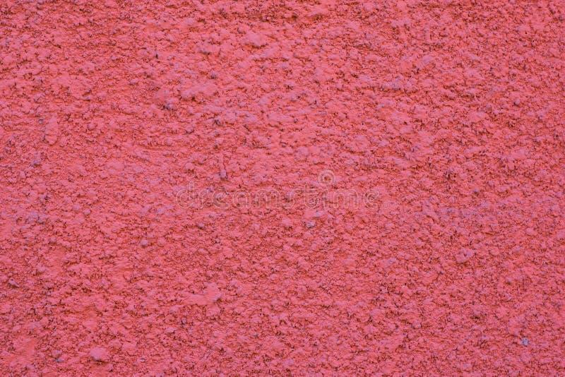 Цемент покрасил предпосылку стены, розовый яркий цвет стоковые фото