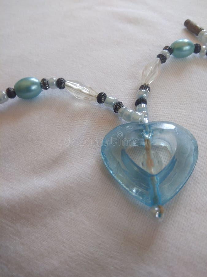 Цепь wera партии сердца форменная с голубыми стержнями стоковое фото rf