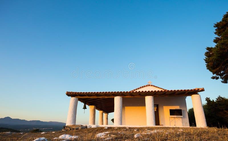 Церковь пророка Ilias во время захода солнца, Греции стоковые изображения