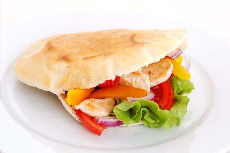 Цыпленок и pita стоковая фотография