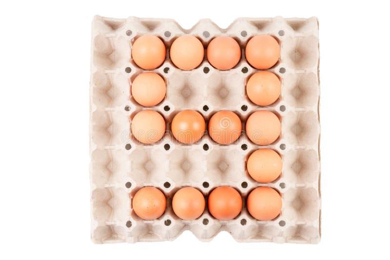 Цыпленок яичка в аранжированной коробке подноса бумажного контейнера выглядеть как номер ` ` 9 стоковая фотография