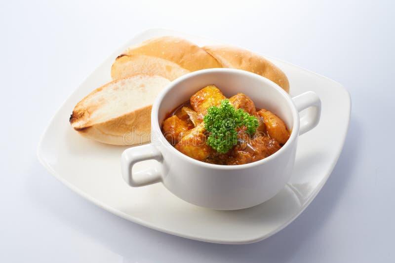 Цыпленок карри с хлебом стоковое изображение