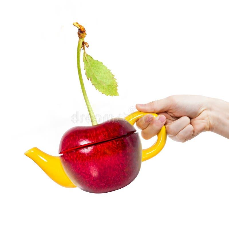 Download Чайник вишни концепции в руке Стоковое Фото - изображение насчитывающей бронированных, китайско: 41650952