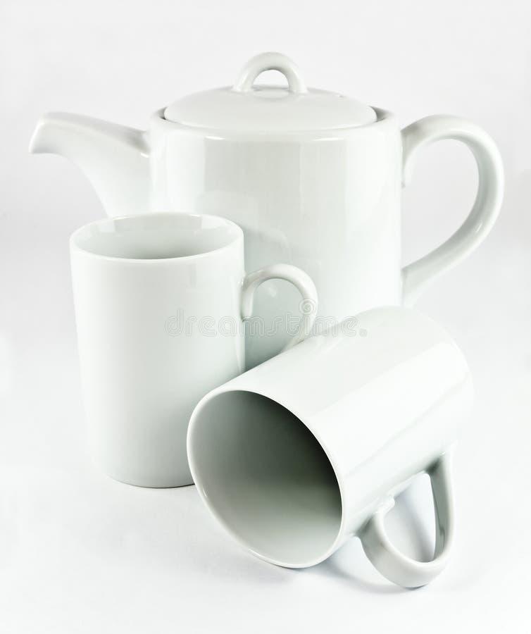Чайник и чашки стоковая фотография rf