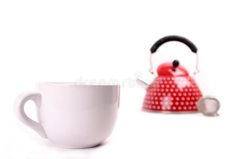 чайник красного цвета чашки стоковые фотографии rf