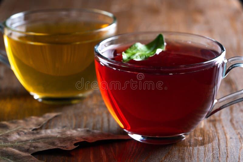 Чай зеленого конца красный стоковые изображения