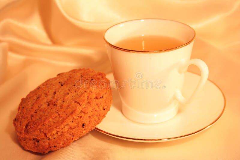 чай чашки печенья стоковая фотография