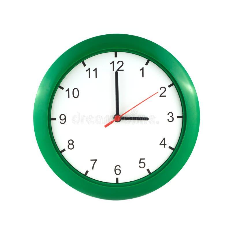 3 часа на зеленых настенных часах стоковое изображение rf