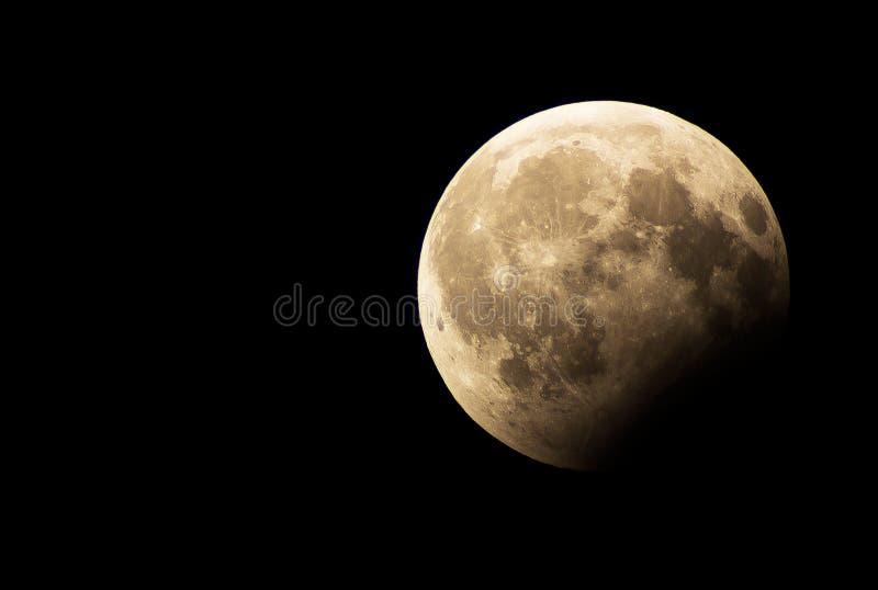 Частичное затмение луны стоковые изображения