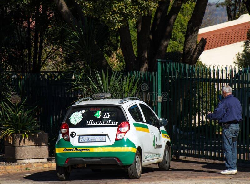 Частные охранные компании защищают жилые дома стоковое фото rf