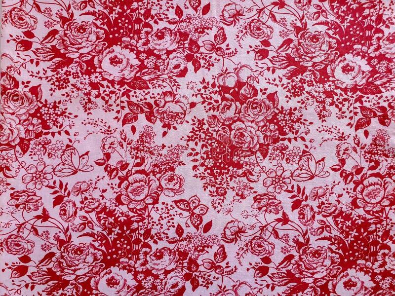 Часть винтажной картины ткани с красным флористическим орнаментом полезным как предпосылка стоковые фотографии rf