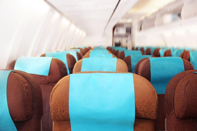 Часть внутри интерьера самолета стоковые фото