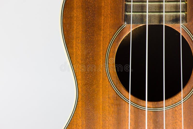 Часть гавайской гитары Брайна изолированная на белизне стоковое изображение rf