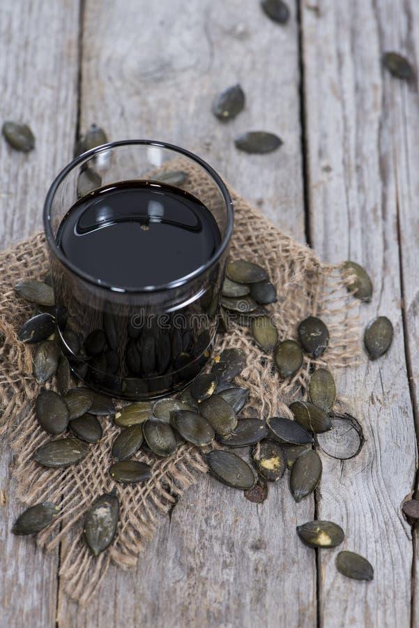 Часть масла семени тыквы стоковое фото rf