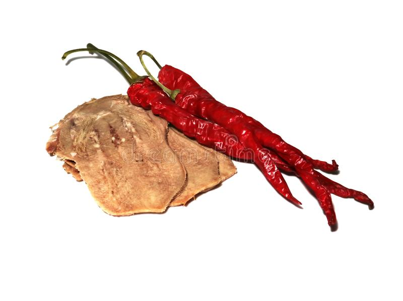 Часть мяса и перец Кайенны изолированный на белизне стоковое фото rf