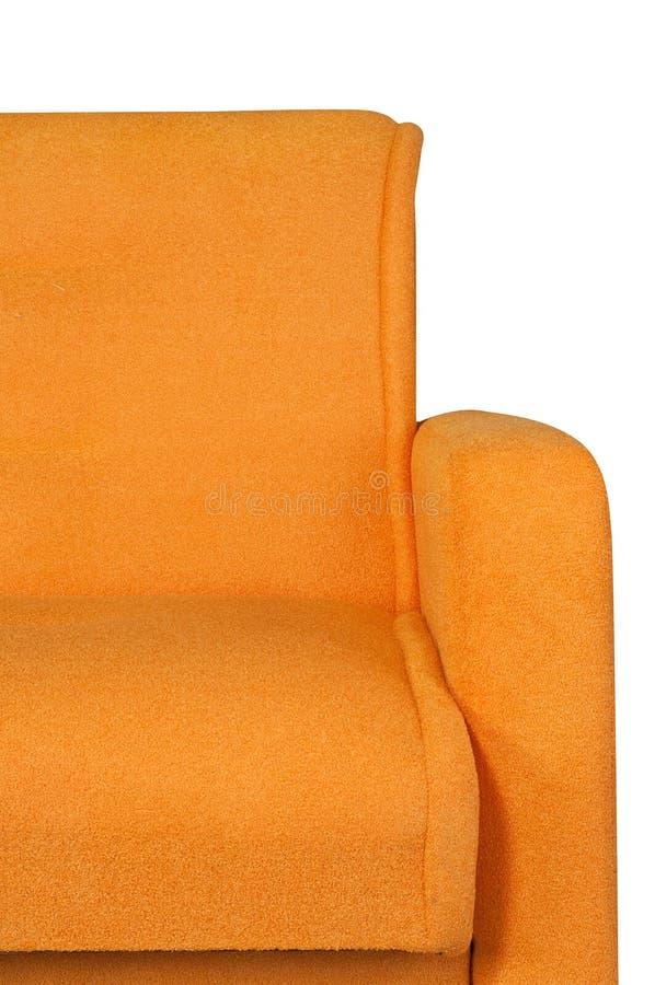 Часть оранжевой мебели софы изолированной на белой предпосылке стоковая фотография