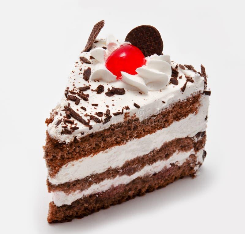 Часть торта шоколада при изолированная вишня стоковое фото rf