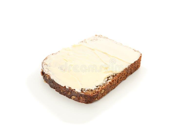 Часть хлеба Rye с маслом изолированным на белой предпосылке стоковая фотография