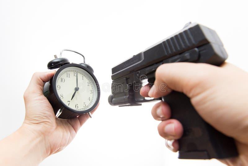 Часы всхода оружия убийства времени стоковые изображения rf