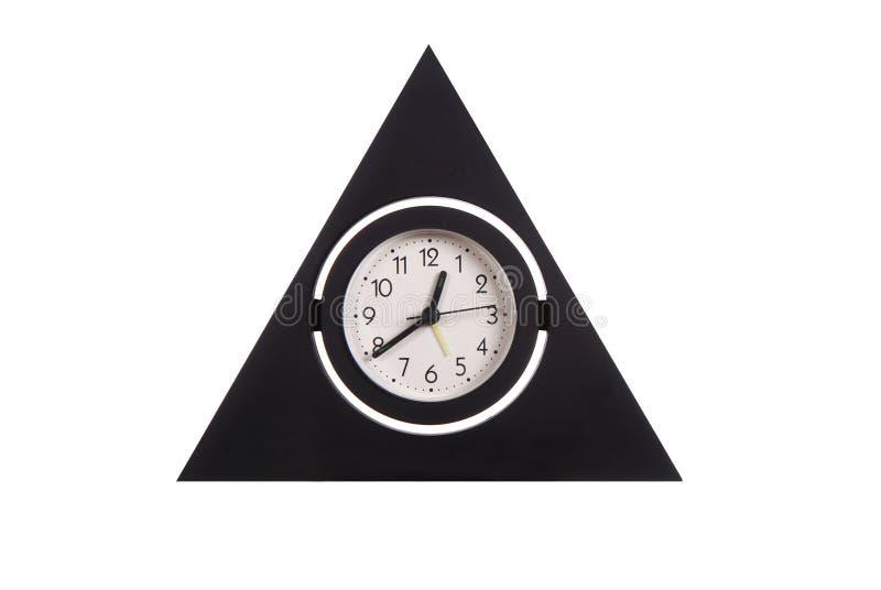 часы загоняли 3 в угол стоковые изображения