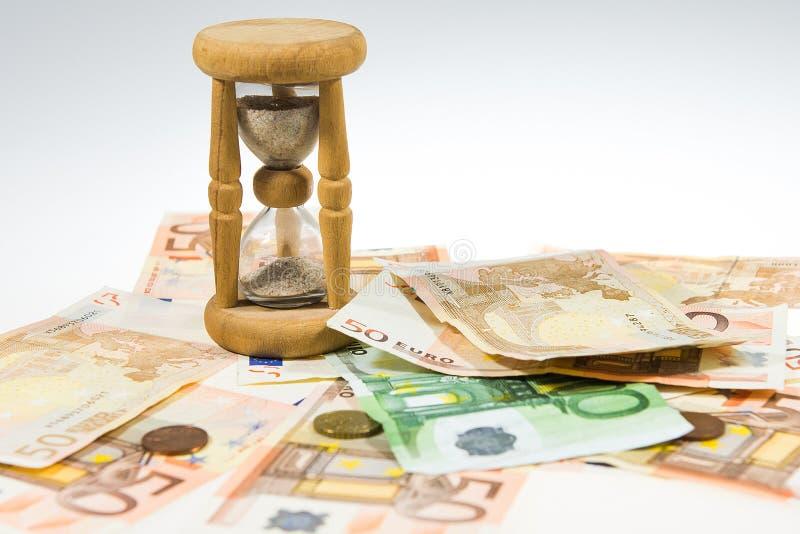 Часы и деньги стоковая фотография