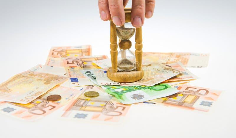 Часы и деньги стоковое фото