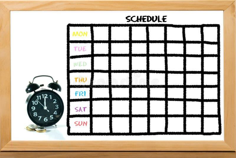 Часы и монетки с план-графиком стоковое изображение rf