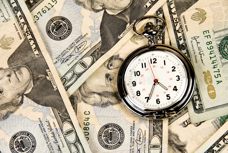 часы наличных дег стоковые изображения