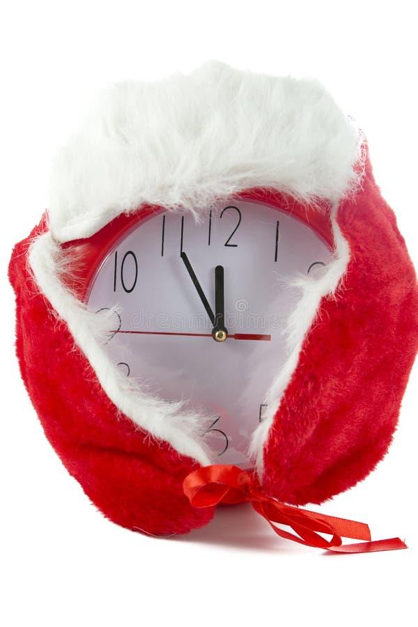 Часы on12 рождества красные стоковое изображение