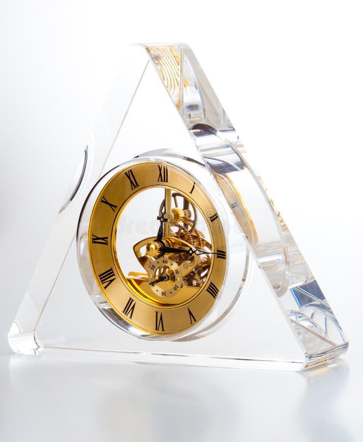 Часы формы треугольника прозрачные стоковая фотография rf