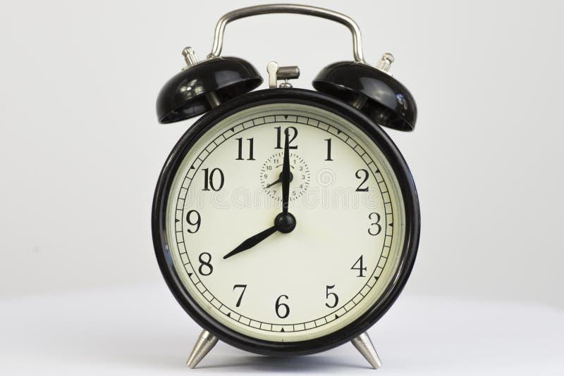 Часы часа сигнала тревоги ретро восьмичасовые стоковое фото
