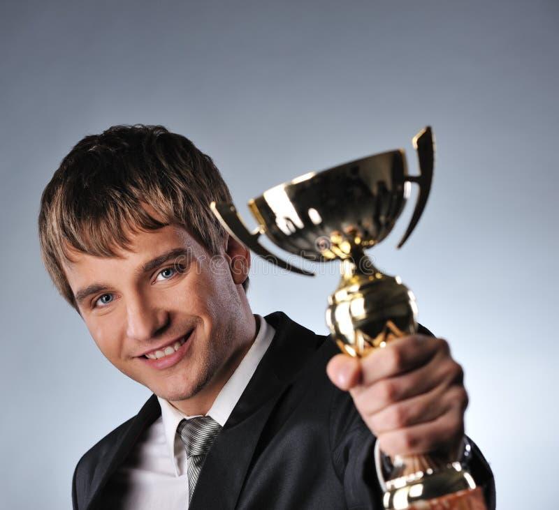 чашка бизнесмена золотистая стоковые изображения rf