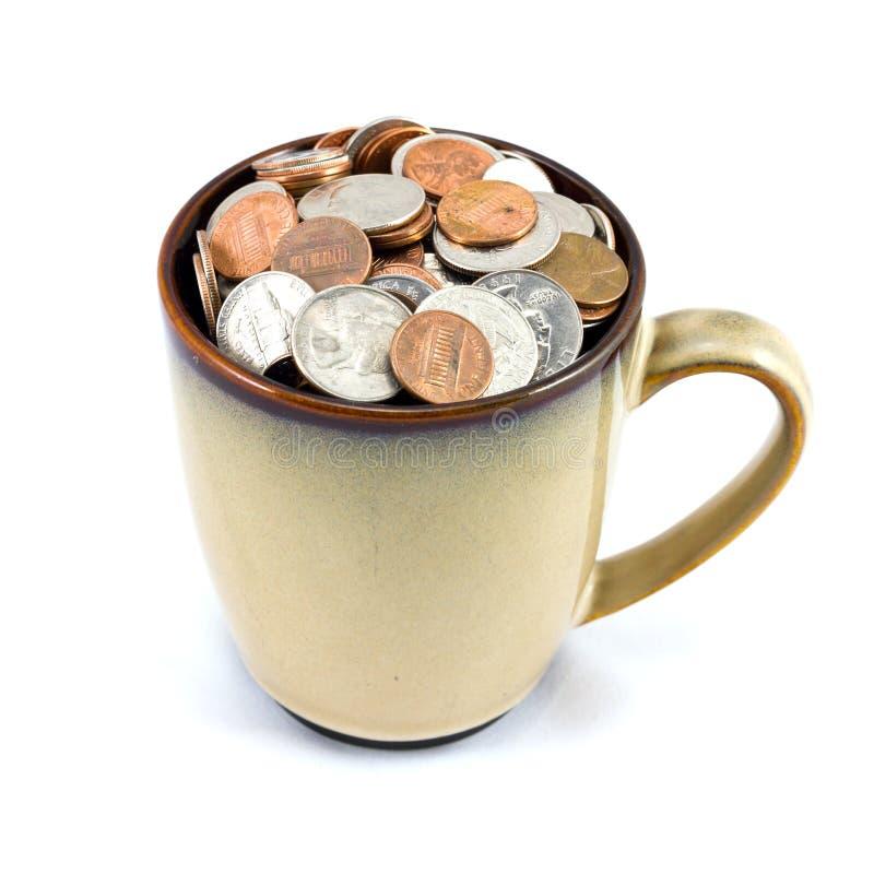 Чашка монеток стоковое изображение rf