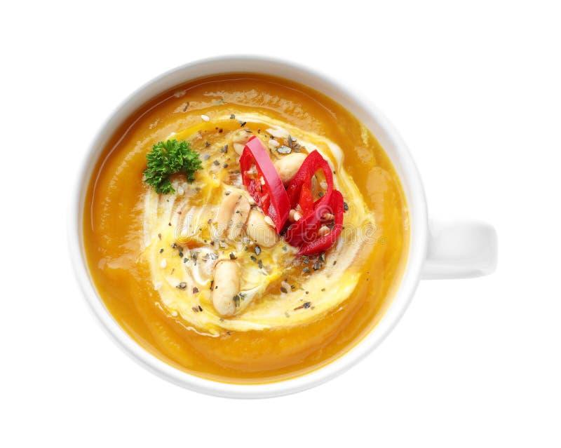Чашка с вкусным супом сливк тыквы на белой предпосылке стоковое фото rf