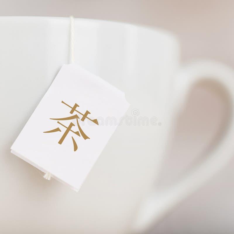 Чашка чая с китайским ярлыком текста стоковое фото rf