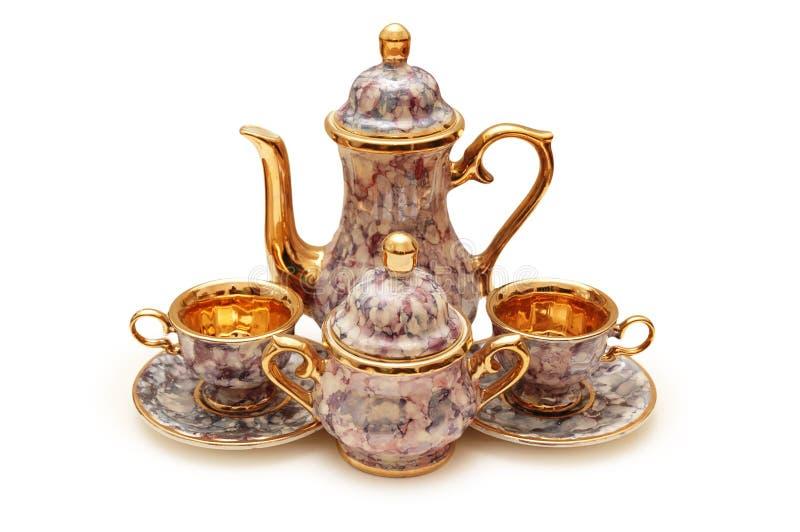 чашки изолировали чайник стоковые фото